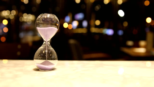 Hourglass on table video