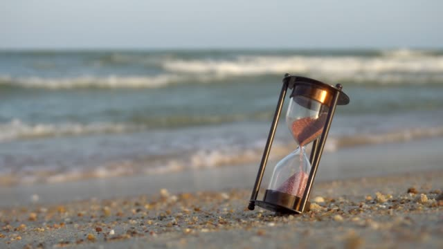 Hourglass on the beach sand beach. Saving time concept Breaking, Instrument of Time, Sand, Summer, Watch hourglass stock videos & royalty-free footage