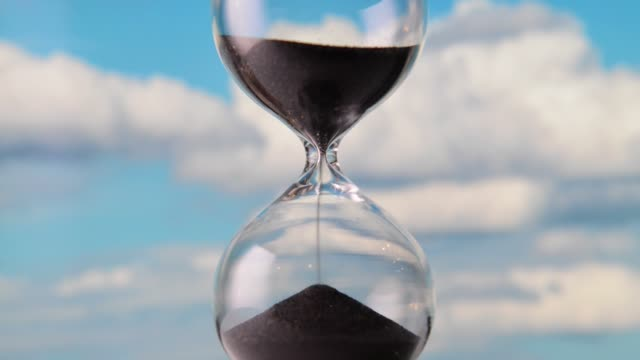 Hourglass Hourglass with sky background hourglass stock videos & royalty-free footage