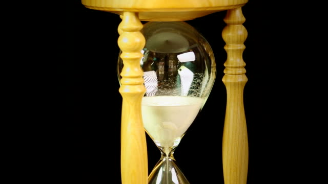 Hourglass with black background video