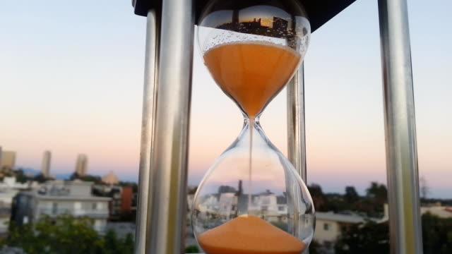 Hourglass with city view background video