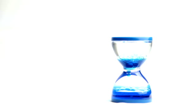 hourglass with colored water marks the passage of time video