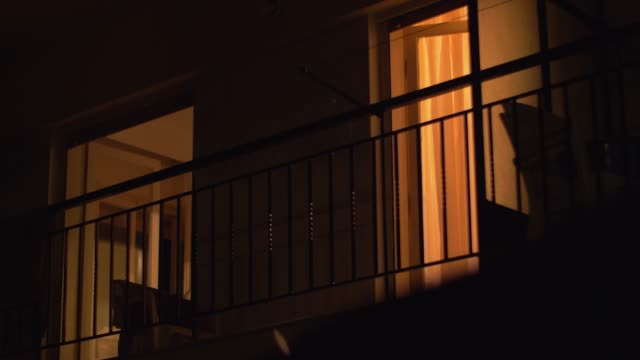 House balcony with open doors at night video