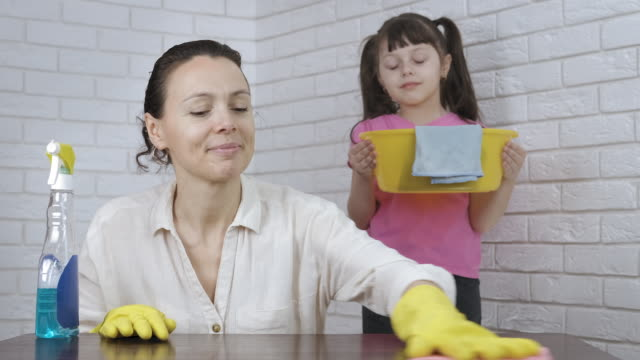 house cleaning with mom. - eastern european descent stock videos & royalty-free footage