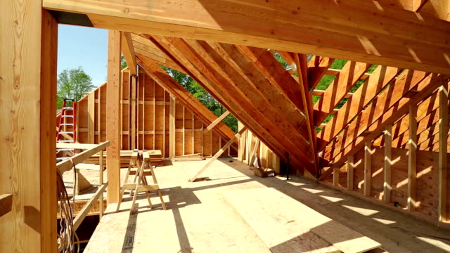House Construction Site Interior of house construction site and construction frame with timber. timber stock videos & royalty-free footage