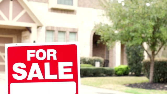 House for sale with real estate sign in yard. video
