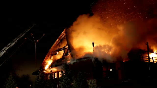 House on fire. Inferno conflagration. House building on fire at night. Inferno conflagration. burning stock videos & royalty-free footage