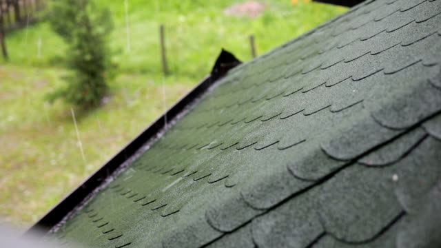 house roof during the hail storm - grandine video stock e b–roll