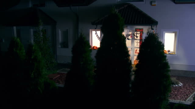 HD CRANE: House With Halloween Decorations At Night video