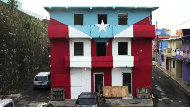 House with Puerto Rican Flag damaged by Hurricane Maria in La Perla, San Juan, Puerto Rico Damaged house with Puerto Rican Flag from Hurricane Maria in La Perla, Old San Juan, Puerto Rico. puerto rico stock videos & royalty-free footage