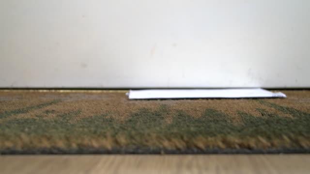 Household bills falling onto front door mat