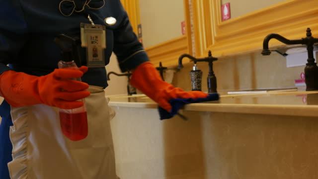 housekeeper cleaning bathroom video