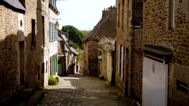 houses at the street of Dinan DINAN, FRANCE - APRIL 06, 2018: view of empty beautiful street with old traditional houses at the center of Dinan, Brittany, France normandy stock videos & royalty-free footage
