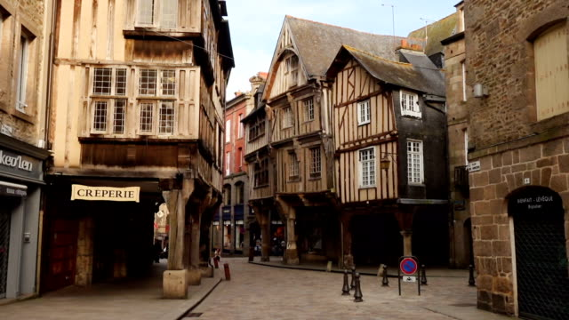 houses at the street of Dinan DINAN, FRANCE - APRIL 06, 2018: view of empty beautiful street with old traditional houses at the center of Dinan, Brittany, France european culture stock videos & royalty-free footage
