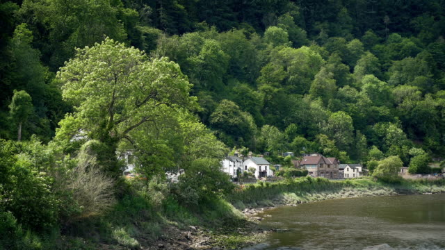 Houses By The River In Pretty Rural Landscape