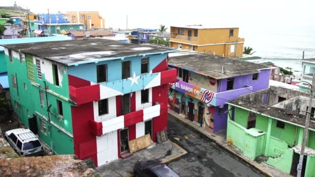 Houses damaged by Hurricane Maria in La Perla, San Juan, Puerto Rico Damaged houses from Hurricane Maria in La Perla, Old San Juan, Puerto Rico. puerto rico stock videos & royalty-free footage