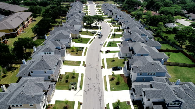 houses Real Estate Development Rows of Suburb Homes symmetry down the center of the street