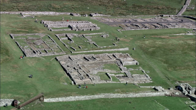 Housesteads Roman Fort  - Aerial View - England, Northumberland, Bardon Mill, United Kingdom Housesteads Roman Fort archaeology stock videos & royalty-free footage
