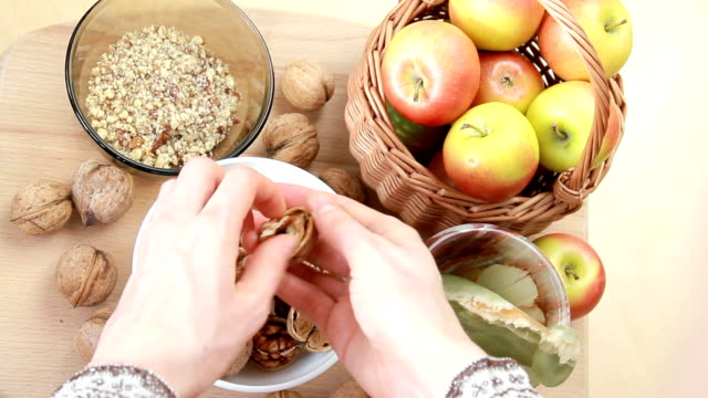 housewife cleans walnuts  from the shell
