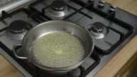 istock Housewife melting butter in steel pan for fry eggs 1198518540