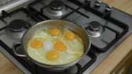 istock Housewife melting butter in steel pan for fry eggs 1198530326