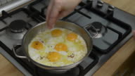 istock Housewife melting butter in steel pan for fry eggs 1198532555