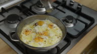 istock Housewife melting butter in steel pan for fry eggs 1198534827
