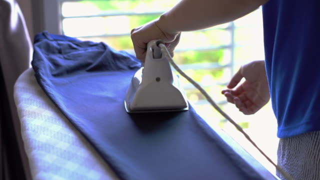 Housewife pressing iron.