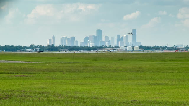 Houston Hobby Airport Action with City Skyline Backdrop Houston TX Hobby Airport Airplane Take-off Action with City Skyline Background on a Sunny Texas Day hobbies stock videos & royalty-free footage