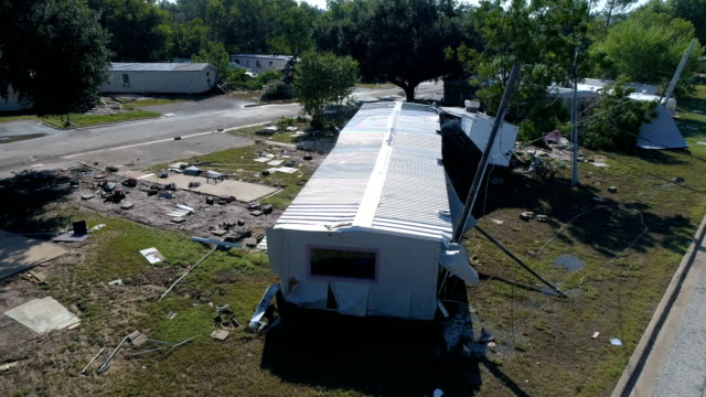 hovering close to destroyed mobile home after flash flood completely destroyed la grange , texas small town gulf coast damage zone from hurricane harvey path of destruction. - gulf coast states stock videos & royalty-free footage