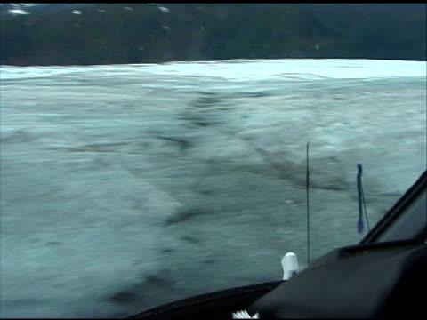Hovering Over Glacier in Helicopter