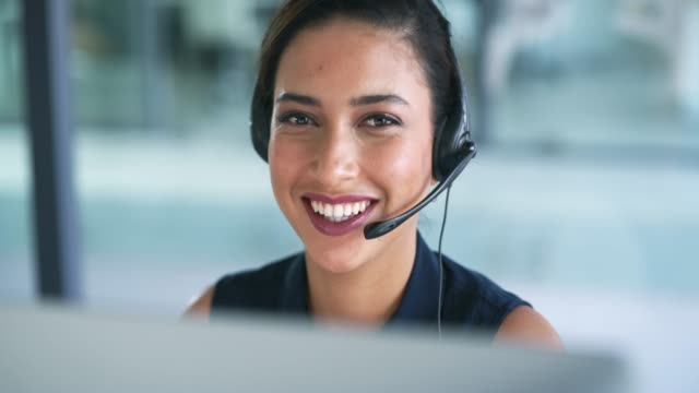 How can I help you? 4k video footage of an attractive young businesswoman working in a call center hands free device stock videos & royalty-free footage