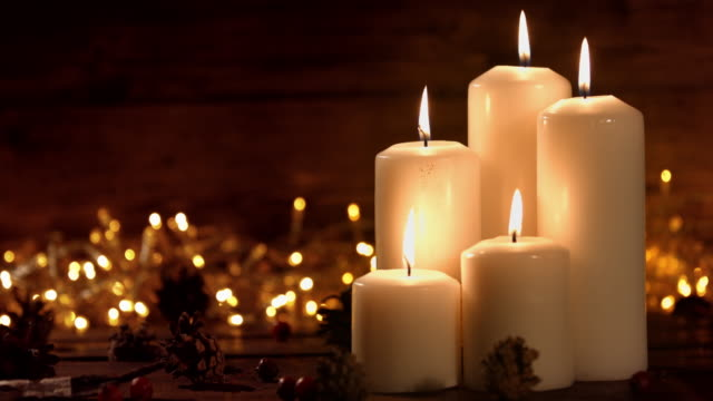 hristmas composition with burning white candles and stars ornaments