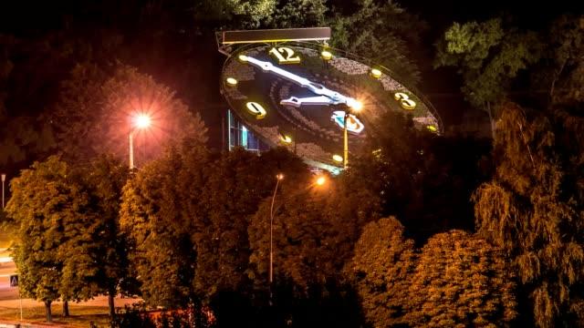 Huge clock in the city jam at night in Krivoy Rog video