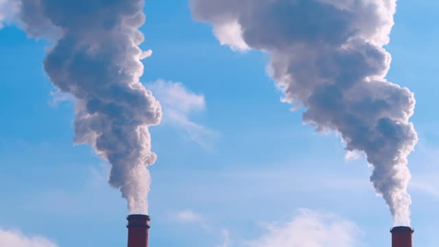 Huge clouds of smoke from industrial chimneys are closed  the blue sky video