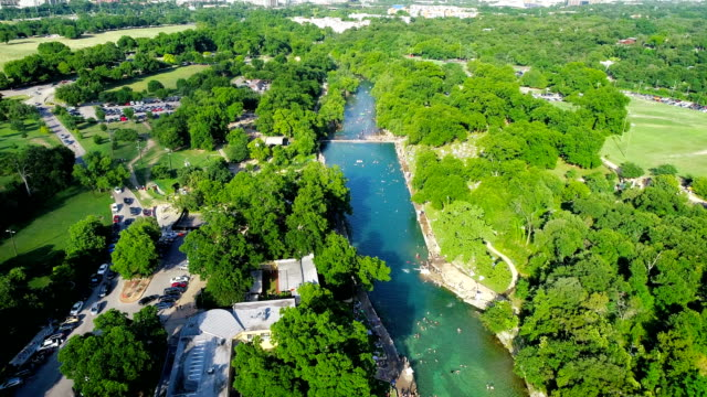 Huge Crowds Swimming at Barton Springs Pool in Austin , Texas