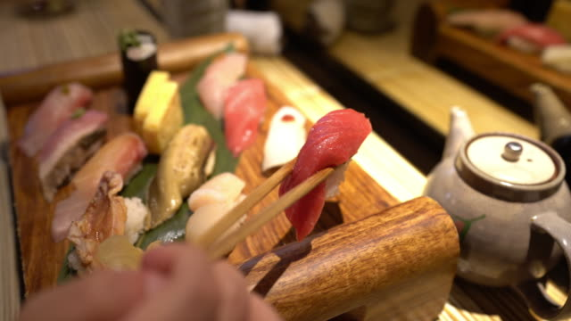 A huge dish with a variety of sushi from the Japanese cuisine
