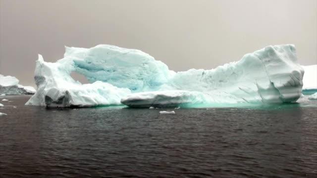 Huge giant iceberg and ice floe in ocean of Antarctica. video