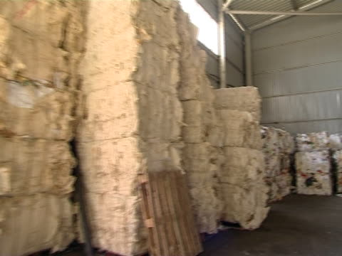 Huge heap of pressed paper placed in warehouse. video