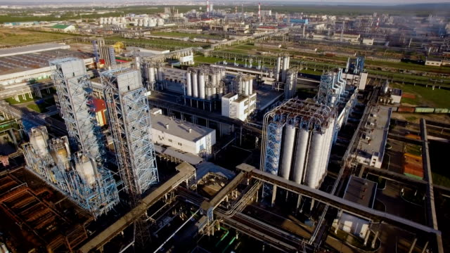 a huge oil refinery with pipes and distillation of the complex. aerial view - centrale elettrica video stock e b–roll