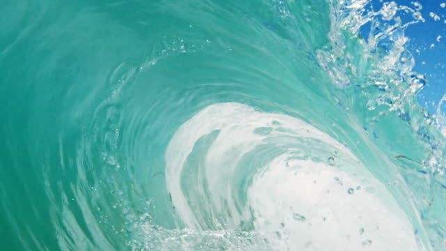 Huge perfect barreling wave POV as wave breaks over camera on shallow sand beach in the California summer sun. Shot in slowmo on the Red Dragon at 300FPS. video