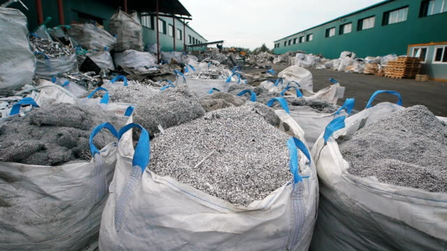 huge piles of metal chips on special storing yard of manufactory - acciaio video stock e b–roll