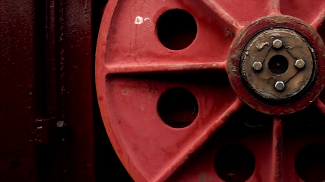 Huge red round handle of mechanism of hydraulic sluice gate on the dam video