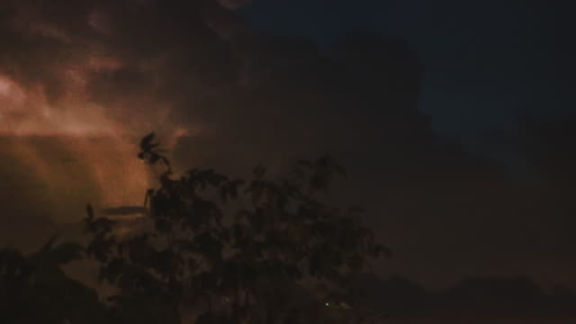 Huge Thunderstorm Cloud with lighting spark (flash) at night