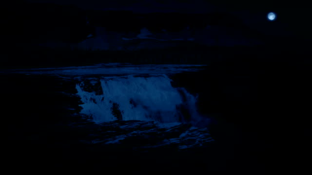 Huge Waterfall In The Mountains At Night video