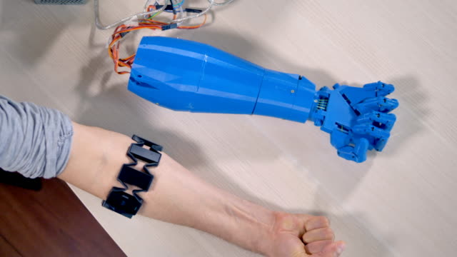 A human and a bionic hands lying beside each other. Top view. video