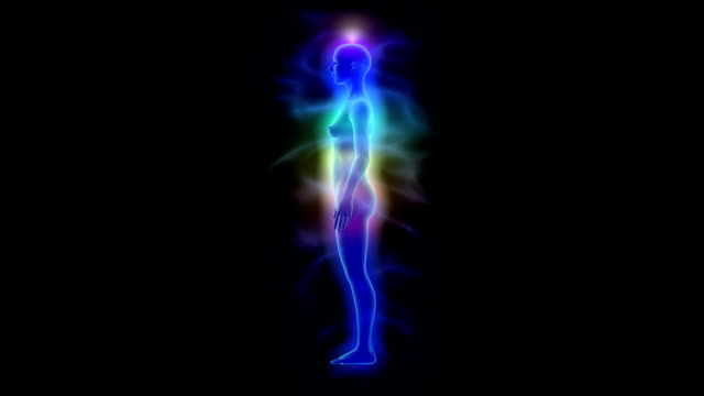 Human aura and chakras - silhouette of woman video