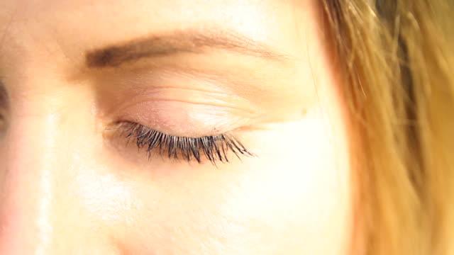 Human blue eye close up video