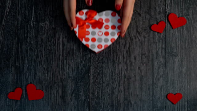 Human hand and gift for Valentine's day Valentine's Day Consept valentines day stock videos & royalty-free footage