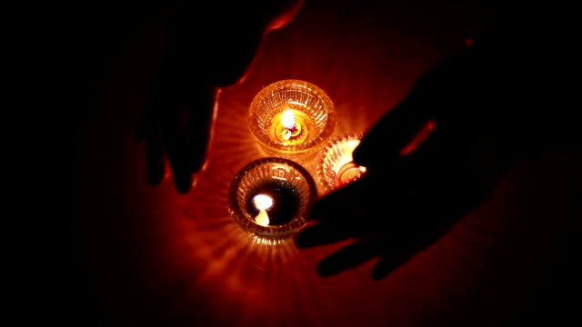 Human hand and oil lamp video